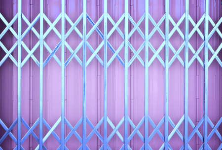 sliding: Purple  metal grille sliding door Stock Photo