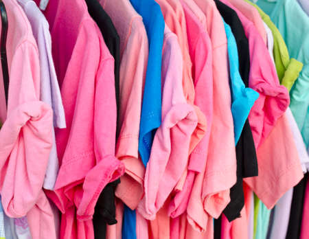 hangers: Colorful t-shirt on hangers Stock Photo