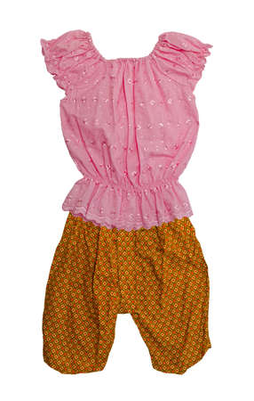 Traditional Thai dress for kids, Thai Jongabaeng Batik pant and Thai cotton shirt outfit Stock Photo