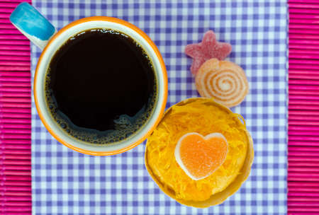 patisserie: coffee and cake on purple gingham .View from above