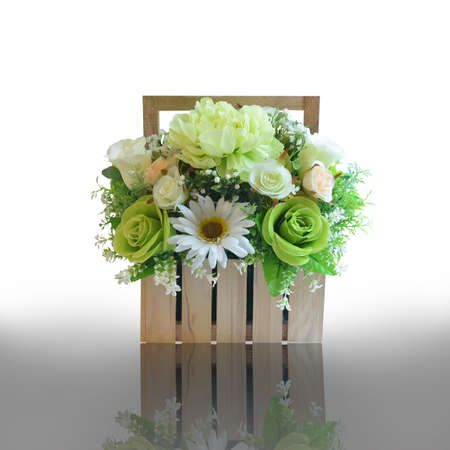 Artificial flower bouquet decorated in basket isolated on white with working path