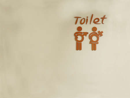 Male and female toilet sign on wall