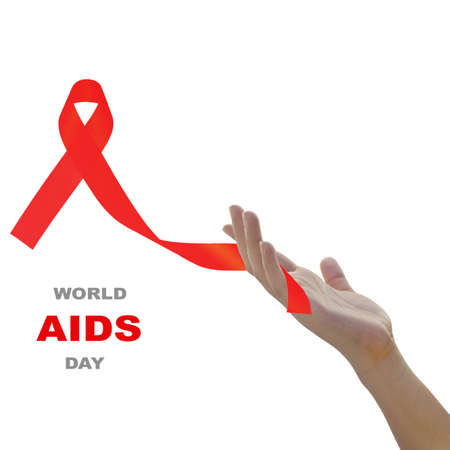 Woman hand holding red  ribbon  against white background for world AIDS day concept