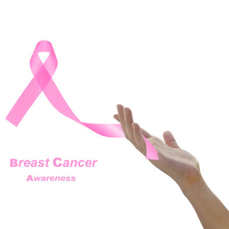 Woman hand holding pink breast cancer awareness ribbon against white background