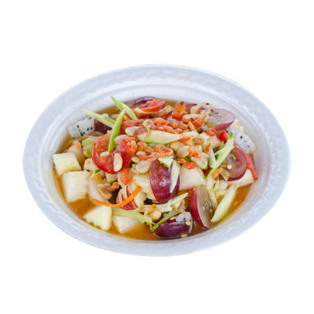 Spicy Thai mixed fruits salad isolated on white background. Stock Photo
