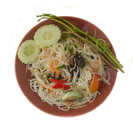 Papaya Salad with Vermicelli, Salted Crab and Fermented Fish on white background Stock Photo