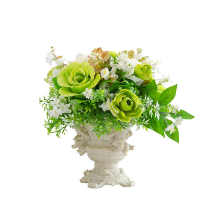 Beautiful white and green artificial flowers in white vase isolated on white background with working path