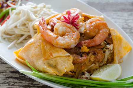 Thai Fried Noodle In Egg Sheet or Pad Thai Prawn Wrap Egg sheet in white plate