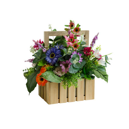 Colorful artificial flower basket decoration isolated on white with working path Stock Photo
