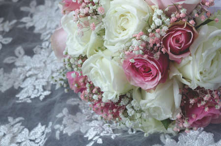 beautiful luxury of mixed flowers  bouquet on white lace textile