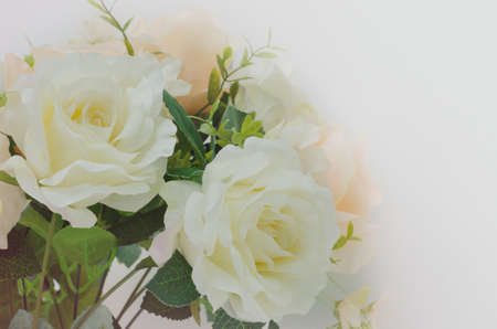 Soft focus artificial white and orange rose flowers bouquet