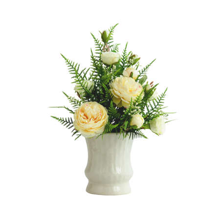 Beautiful artificial yellow roses arrangement  isolated on white background with working path