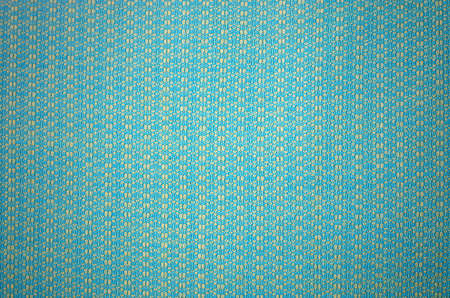 Light blue and yellow knitted fabric pattern texture background