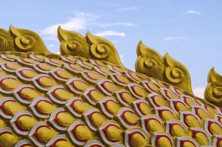 Dragon tail sculpture over lue sky background