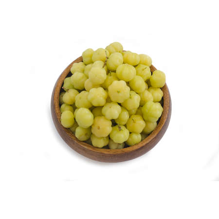 Star gooseberry fruit in wood bowl on white background with working path