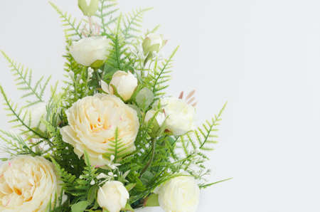 Beautiful artificial yellow roses arrangement  isolated on white background