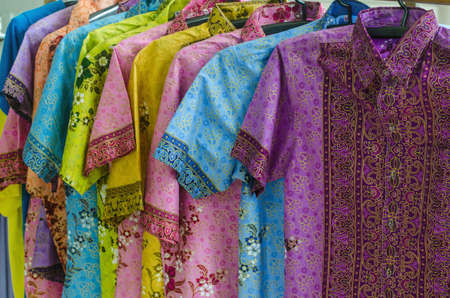 Beautiful and colorful batik shirt, hang on a shelf in a shopping mall in south of Thailand