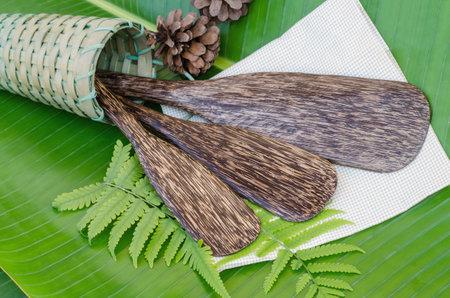 Palm sugar paddles on green banana leaf