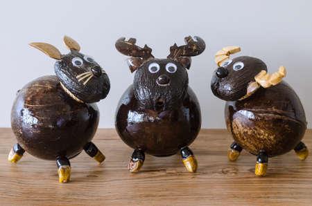 Lovely handmade deer buffalo and rabbit piggy bank made from coconut shell and palmyra palm shell Standard-Bild
