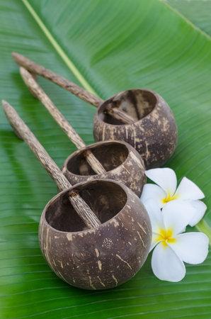 Old thai style coconutshell ladles on banana leaf