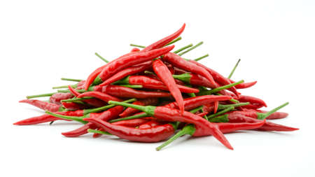 Stack of hot chili pepper or small chili padi, isolated on white background Stock Photo