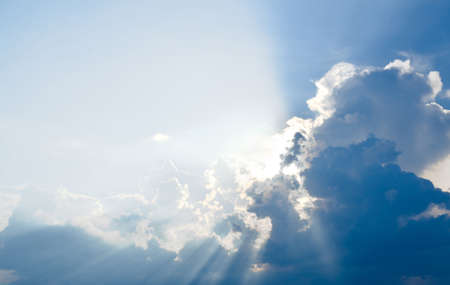 Blue sky & clouds with sun rays, bright & shining, Good for travel or wanderlust background. Stock Photo