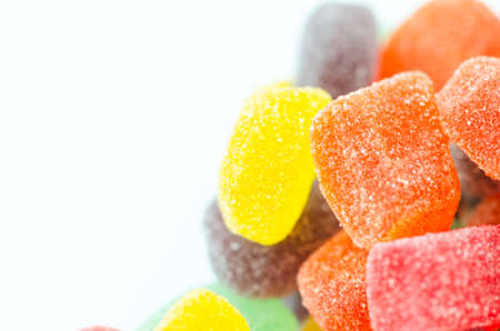 Macro closeup for bunch or pile of colorful jelly candy or sweets, background isolation on white. Good for health conceptual.