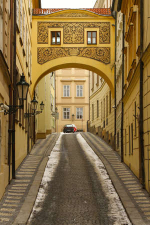 Archway over the cobble stone street in Prague