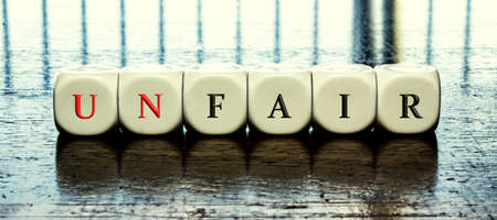 Banner with word fair or unfair - dilema concept - dices forming word