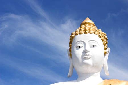 Buddha head in a blue sky