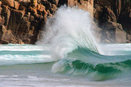 colliding: COLLIDING WAVES, CORNWALL, UK Stock Photo