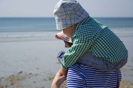 holidaying: MOTHER AND SON AT THE BEACH Stock Photo