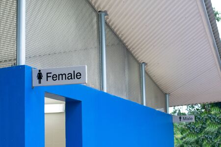 Female bathroom in front of male bathroom
