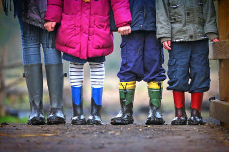 wellingtons: Muddy childrens boots Stock Photo