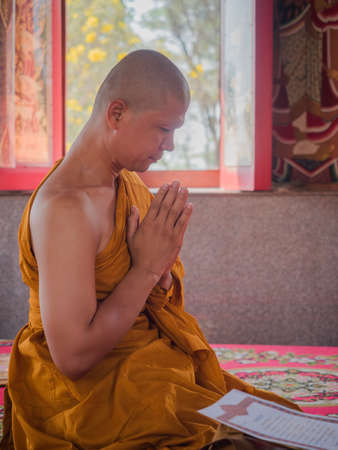 ordain: March 9, 2016, Nakhon Pathom, Thailand. The ordination of a Buddhist monk. Editorial