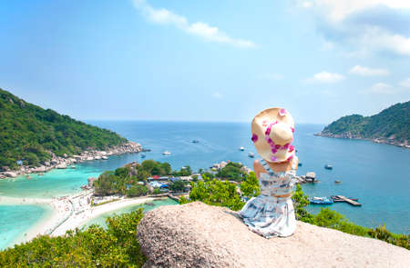 Asian woman sitting on stone in Amazing View point in Nangyuan Island. photo