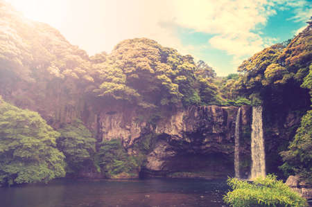 background waterfalls: Cheonjiyeon Waterfall is a waterfall on Jeju Island, South Korea. Vintage and Retro tone.