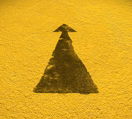 yellow: Road arrow direction with Yellow floor background. With Clipping Path. Stock Photo