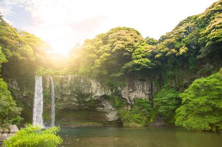 Summer Season of Cheonjiyeon Waterfall on Jeju Island, South Korea.