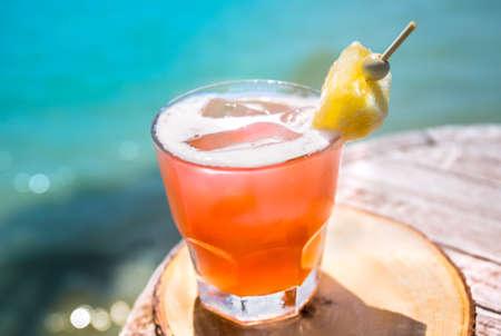 Mai Tai drink on beach bar. Close up of alcoholic drink. Stock Photo