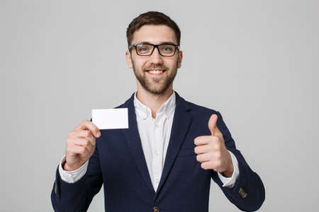 thump: Business Concept - Portrait Handsome Business man showing name card with smiling confident face and thump up. White Background.Copy Space.