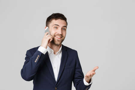Lifestyle and Business Concept - Portrait of a handsome businessman enjoy talking with mobile phone. Isolated White background. Copy Space.