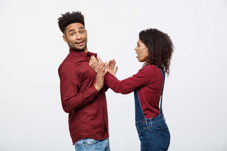 Unhappy African American couple in casual clothes arguing and figthing. Stock Photo