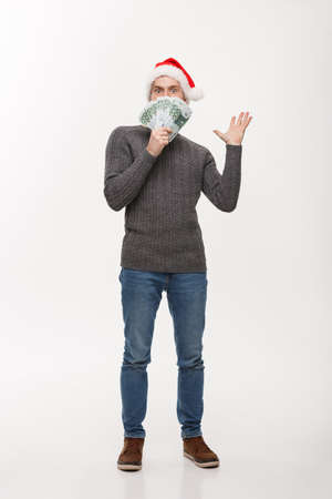 Holiday Concept - young beard man holding money in front over white background 版權商用圖片 - 96695610