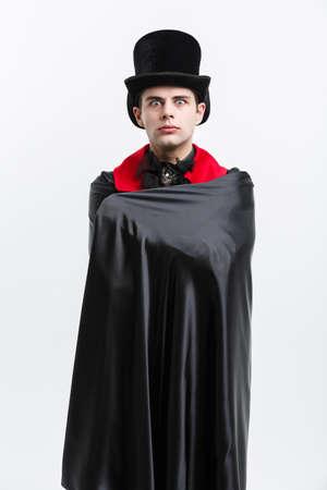 Vampire Halloween Concept - Portrait of caucasian vampire sleeping in halloween dracula costume.