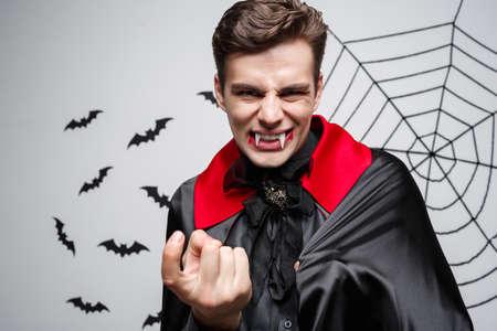 Vampire Halloween Concept - Portrait of Angry caucasian vampire screaming. Stock Photo