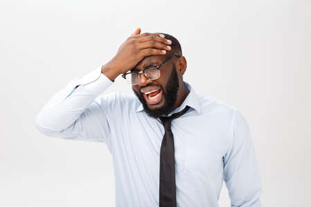 Portrait of desperate annoyed black male screaming in rage and anger tearing his hair out while feeling furious and mad with something. Negative human face expressions, emotions and feelings. Stok Fotoğraf