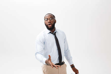 Portrait of angry or annoyed young African American man in white polo shirt looking at the camera with displeased expression. Negative human expressions, emotions, feelings. Body language.