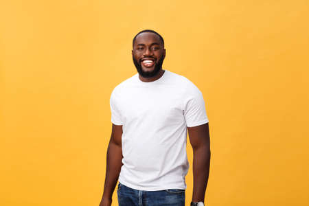 Portrait of delighted African American male with positive smile, white perfect teeth, looks happily at camera, being successful enterpreneur, wears white t shirt. Stock fotó - 110815307
