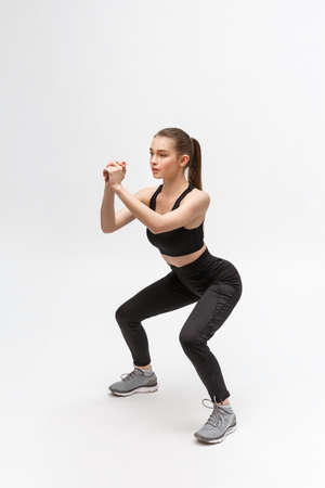 Exercise. Sports Woman In Fashion Sportswear Stretching Legs